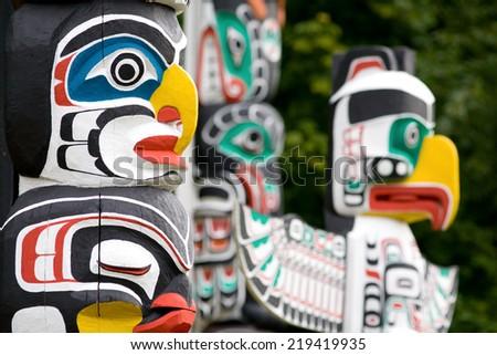 Coast Salish totem poles in Stanley Park, Vancouver, British Columbia - stock photo