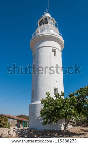 Coast white lighthouse against a blue sky on the island of Cyprus