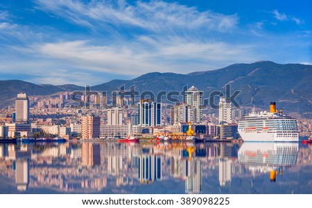 Coastal cityscape with modern buildings under cloudy sky Izmir city - stock photo