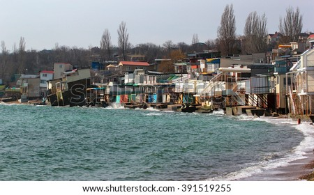 Coastal erosion - houses built on weak clay soil slide down to the sea in Odessa, Ukraine. - stock photo