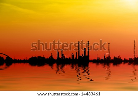 Coastal Factory cityscape with reflection - stock photo