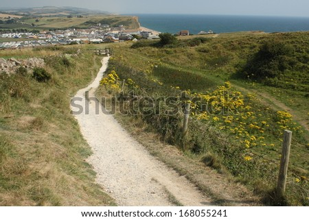 coastal footpath above West Bay in Dorset - stock photo