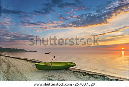 Coastal landscape at dawn with fishing boats, Baltic Sea, Latvia - stock photo