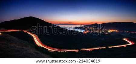 Coastal landscape at dusk with light trails