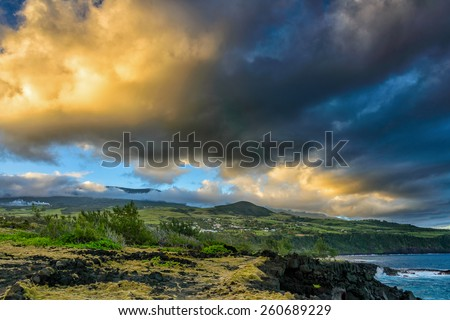 Coastal landscape at sunset with spectacular clouds in la Reunion island - stock photo