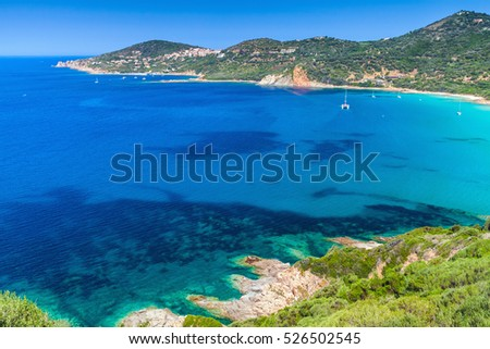 Coastal landscape of South Corsica. Small azure bay with yachts. Piana region, France