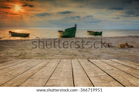 Coastal landscape with anchored fishing boats accounted for traditional fisheries, Baltic Sea - stock photo