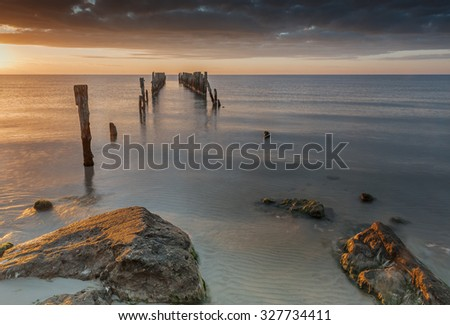 Coastal landscape with old broken pier, Baltic Sea, Europe - stock photo