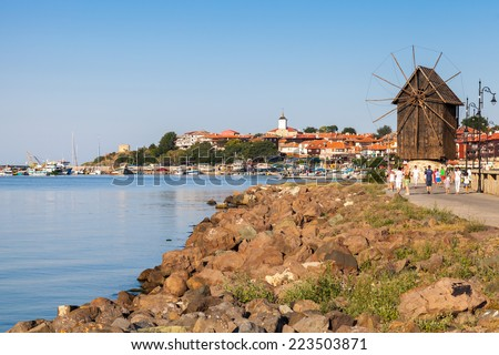 Coastal landscape with old windmill. Ancient town Nessebar, Bulgaria. Black Sea coast in sunny day - stock photo