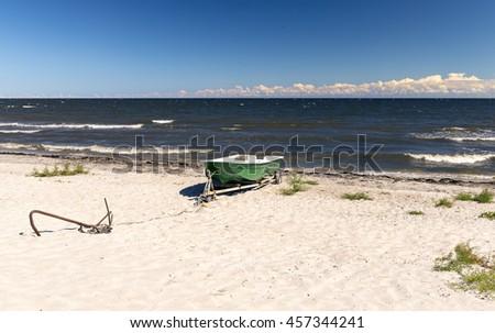 Coastal landscape with plastic fishing boat, Baltic Sea, Latvia - stock photo