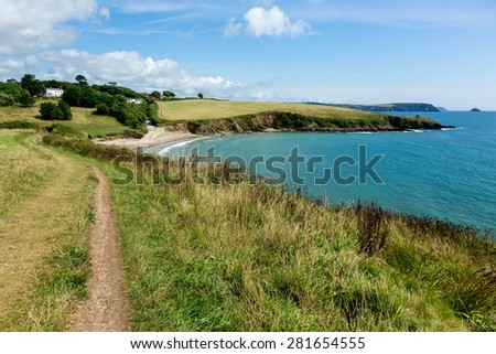 Coastal Pathway leading to Porthcurnick Beach Cornwall England Landscape - stock photo
