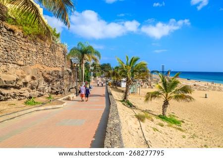 Coastal promenade along sandy beach in Morro Jable town, Fuerteventura, Canary Islands, Spain - stock photo