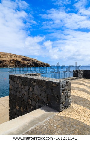 Coastal promenade sea view black volcanic stone wall, Madeira island, Portugal  - stock photo