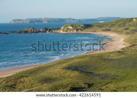 Coastal road between the Giant's Causeway and Ballycastle in Northern Ireland. Stunning views, cliffs, rugged rocky coastlines, quaint villages, sandy beaches, steep, narrow winding roads. - stock photo