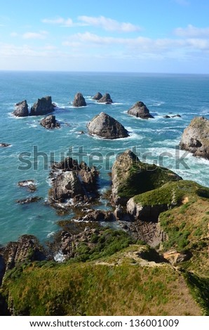 Coastal rocks and cliffs, Nugget Point--Catlins, New Zealand - stock photo