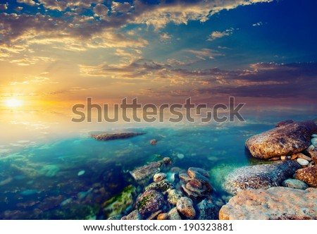 Coastal rocks and sunset. Vintage picture