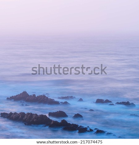 Coastal rocks at sunrise in Mossel Town, South Africa  - stock photo