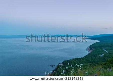 Coastal Scene on the Cabot Trail at dusk (Cape Breton, Nova Scotia, Canada) - stock photo