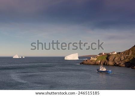 Coastal seascape with iceberg. - stock photo
