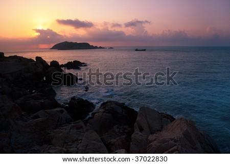 Coastal Sunrise on the rocky coastline in the southeast of China - stock photo
