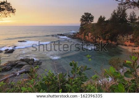 Coastal sunset at the Tip of Borneo, Sabah, Malaysia - stock photo