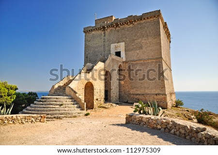 Coastal tower. Coastal tower in Porto Selvaggio, a natural park near Nardo, in Apulia. Italy. - stock photo
