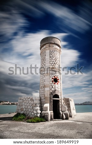 Coastal tower in the harbor - stock photo