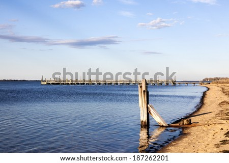 Coastline and pier located at Fire Island National Seashore. - stock photo