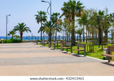 Coastline and promenade in Limassol, island Cyprus, Europe, Mediterranean Sea. Bright sunny day and blue water and sky.