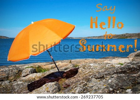 Coastline Bohuslan Archipelago Swedish West Coast With Rocks And Cliffs And Beach With Orange Parasol And English Life Quote Say Hello To Summer With Ocean And Open Sea Sunny Weather With Blue Sky - stock photo