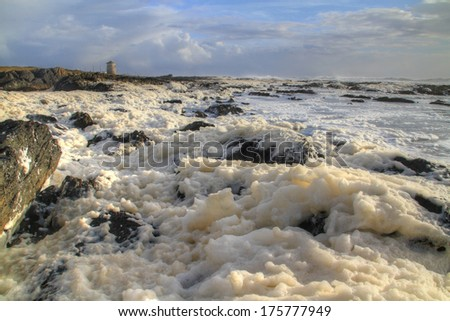 Coastline covered with sea foam, Viana do Castelo, Portugal (HDR photo) - stock photo