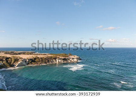 Coastline in Barbados. Ocean Water and blue Sky. Beach with Rocks.