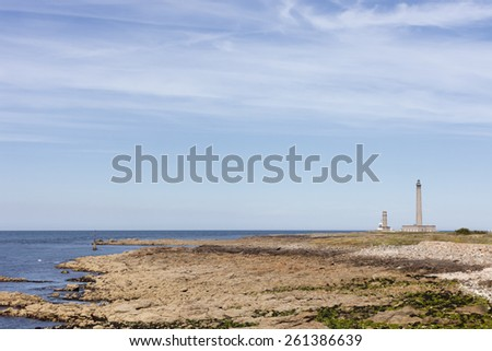 Coastline in Normandy with lighthouse - Phare de Gatteville, Barfleur, Basse Normandy, France -The third tallest traditional lighthouse in the world was built 1774. - stock photo
