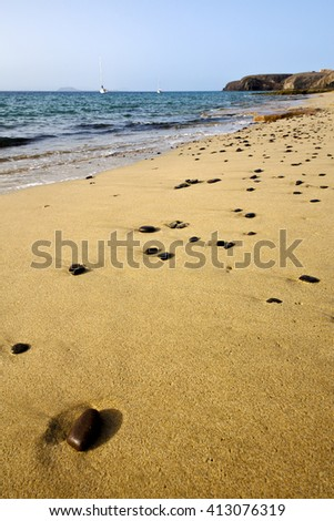 coastline lanzarote  in spain musk pond beach  water yacht boat  and summer  - stock photo