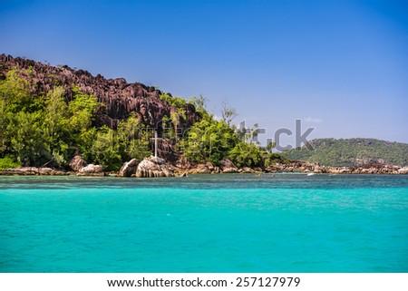 Coastline of Mahe island, Seychelles. Clear blue sky - stock photo