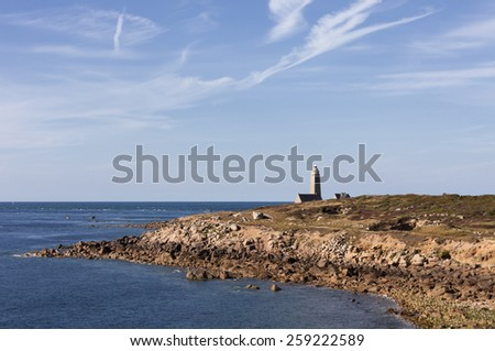 Coastline on peninsula Cotentin in Normandy with lighthouse - Phare du Cap Levi, Fermanville, Basse Normandy, France - stock photo