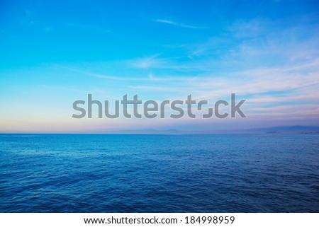 Coastline or ocean dawn with clear blue sky   - stock photo