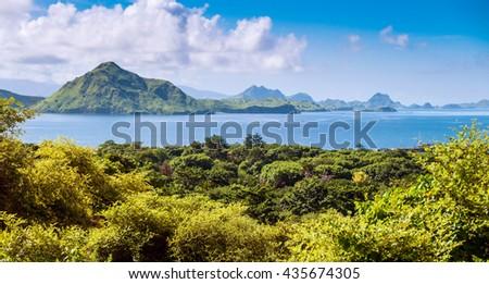 Coastline with offshore islands, Komodo National Park, Unesco World Heritage Site, Lesser Sunda Islands - stock photo