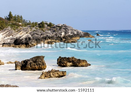 Coastline with very blue waters - stock photo
