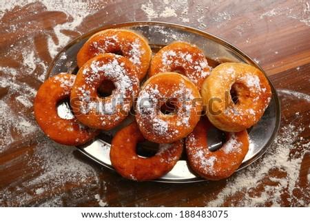 Coat Donut with Powdered sugar. Making Doughnuts - stock photo