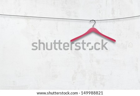 coat hanger on a white wall - stock photo