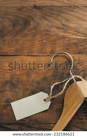 Coat Hanger with Blank Tag - stock photo