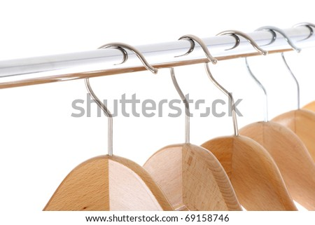 coat hangers on a clothes rail, close up - stock photo