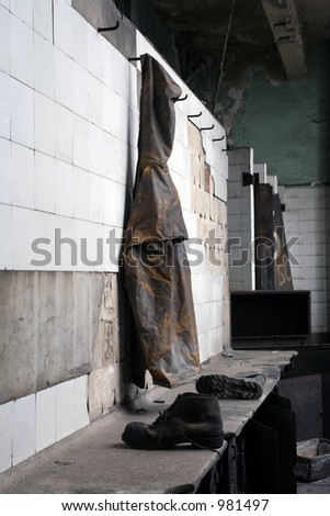 Coat haning in abandoned dressing room - stock photo