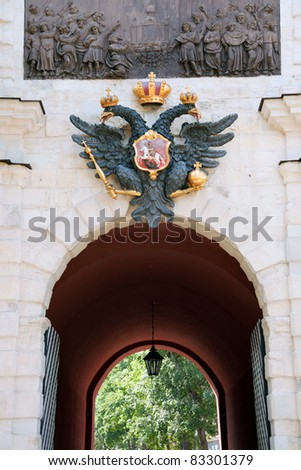 Coat of arms of Russian empire above the gates of Peter and Paul fortress - stock photo