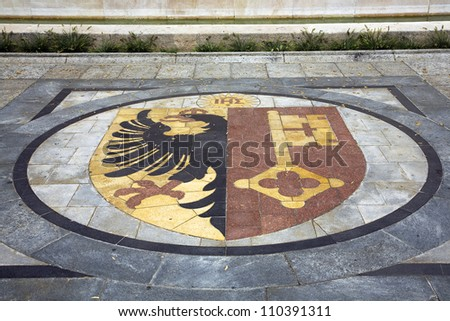 Coat of arms of the Swiss canton of Geneva.  The black eagle is the emblem of Roman kingdom and the golden key is the symbol of Saint Peter. - stock photo
