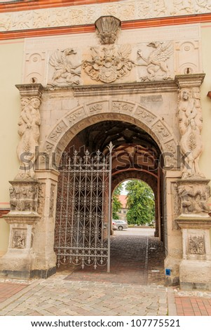 Coat of arms on doorway in historic Wismar, a Hanseatic League town in Northern Germany on the Baltic Sea, with elegant building styles from 14th-century Gothic to 19th-century Romanesque revival. - stock photo