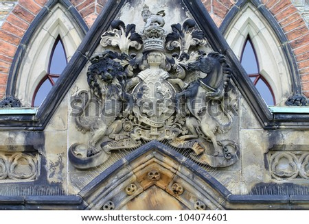 Coat of Arms sculpture above the entrance of East Block Parliament Buildings, Ottawa, Canada - stock photo