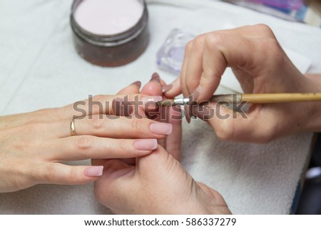 coated acrylic nails in a beauty salon