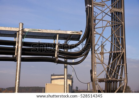 Coax cables under ice bridge and starting climb of 400' guyed tower